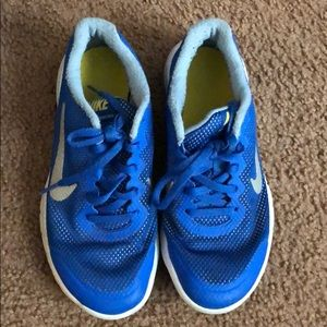 Royal blue and white nike sneakers for boys.Sz 4.5